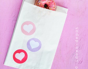 10 paper bags with 3 hearts