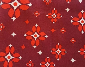 """Free Spirit, 100% cotton fabric. Grand Hotel by Jenean Morrison. """"Concierge"""" in red."""