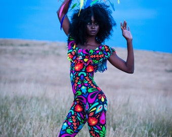 Femina Magicae Rainbow Off The Shoulder Pom Pom Frill Catsuit. Black Festival Bardot Jumpsuit. Perfect for; parties, burning man, clubbing