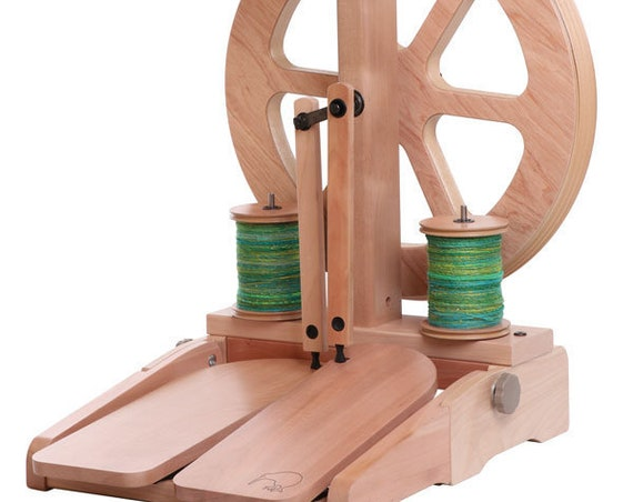 Kiwi Spinning Wheel 3