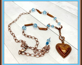 Forget-Me-Not Gingerbread pewter heart with Treble Clef and flower blue Swarovski crystals and a copper chain.