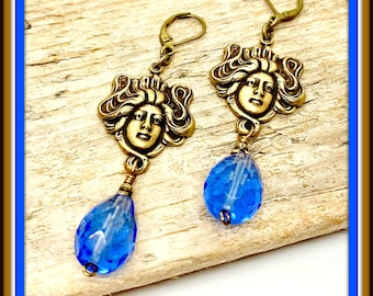 Large faceted Sapphire glass drops with brass ox bead caps and Brass Ox ladies with matching lever back hooks.