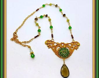 Classic French Gold winged base with 20mm vintage peridot Swarovski crystal focal and a Smoky Quartz  drop and matching crystals in neckline