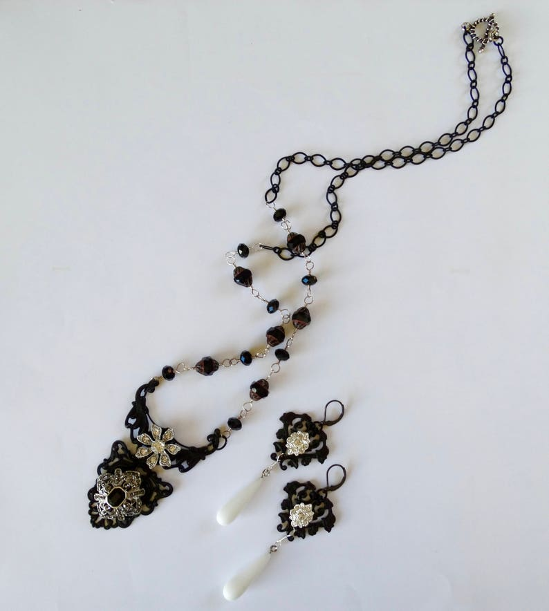 Matte Black Art nouveau backer Black and Silver Necklace Up-cycled  Rhinestone and Onyx focal w matching Black and White Earrings.
