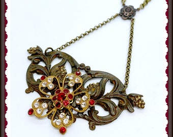 Vintage French Flower set with Swarovski crystals on a Rusty Black floral base with matching chain.