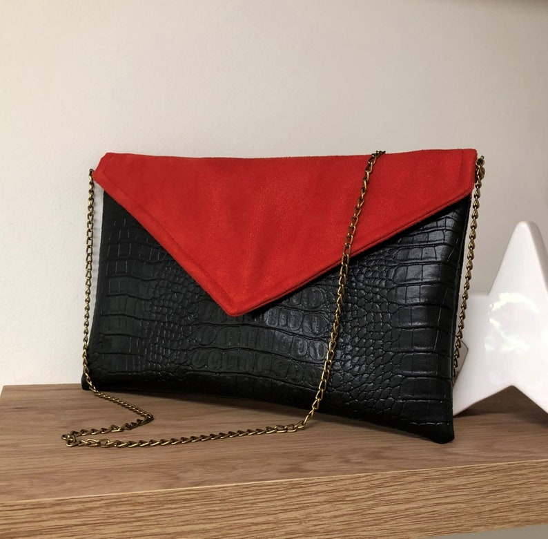 Black and red evening clutch bag crocodile vegetable leather image 0