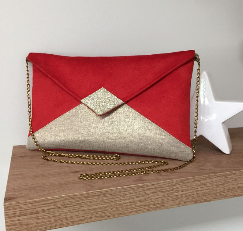 Evening bag in red suedette and iridescent gold linen with image 0