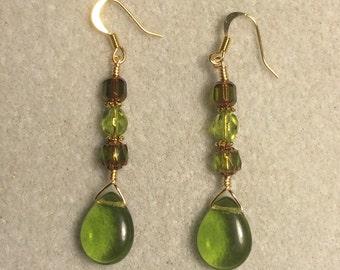 Olive green Czech glass pear drop earrings adorned with olive green Czech glass beads.
