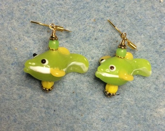 Lime green and yellow lampwork fish bead earrings adorned with lime green and yellow Czech glass beads.