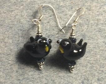 Vintage black lampwork raven bead earrings adorned with black Chinese crystal beads.