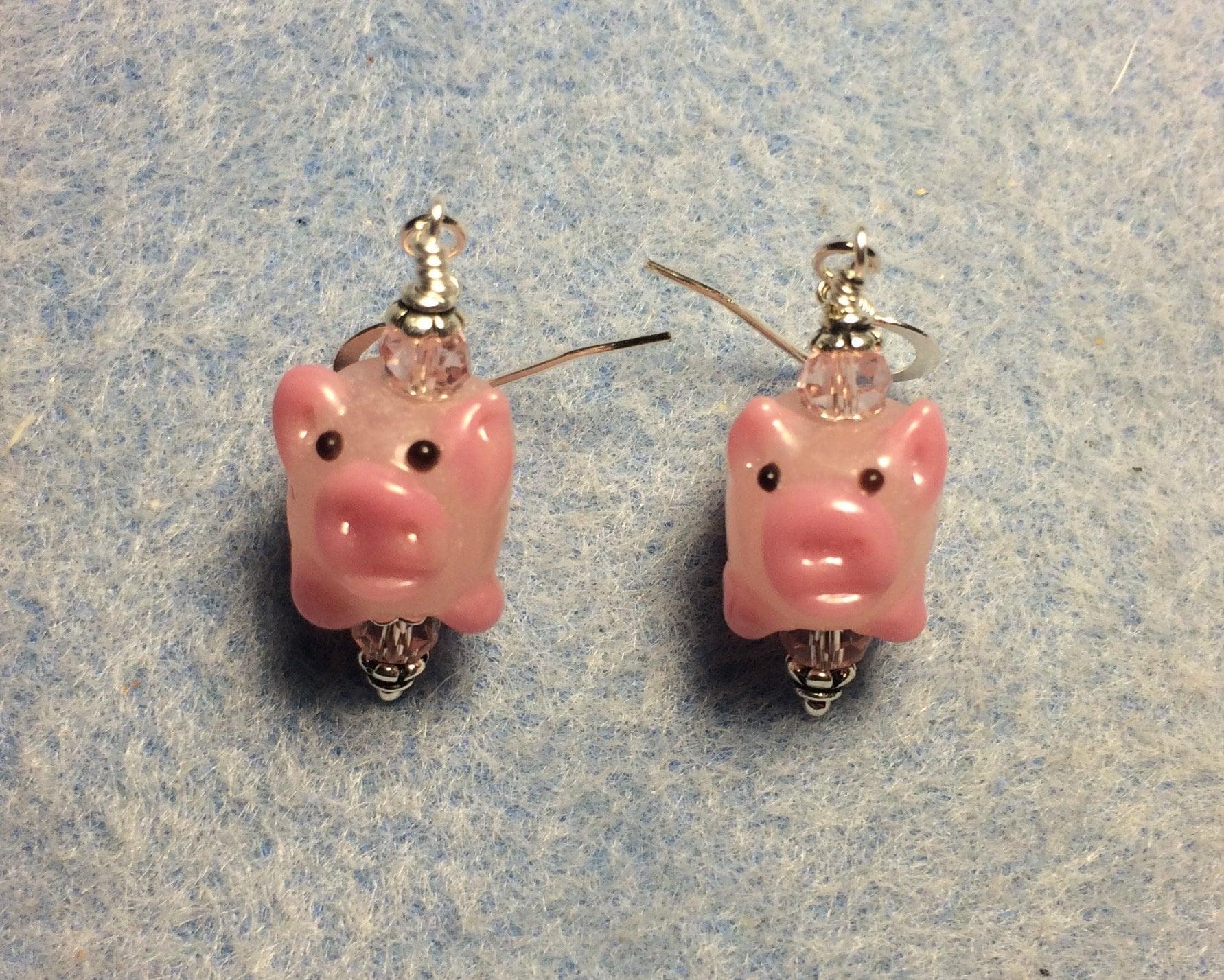 Small red lampwork pig bead earrings adorned with red Czech glass beads. Red lamp work pig earrings