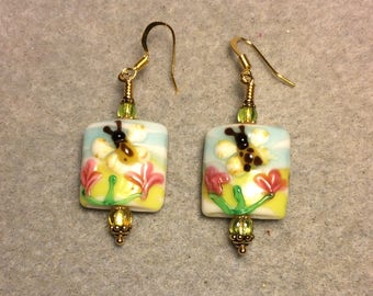 Lime green, yellow, black and pink lampwork honeybee and flower bead earrings adorned with lime green Czech glass beads.