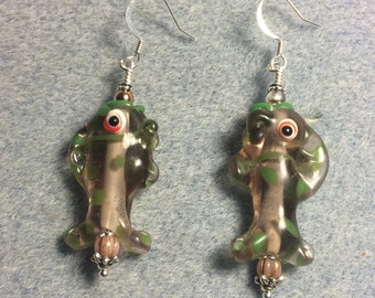 Pink and green lampwork fish bead earrings adorned with pink Czech glass beads.