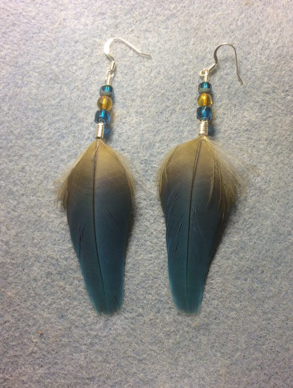 Long feather gold pendant earrings with blue and red glass beads