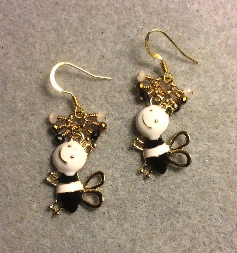 Black and white enamel silly honeybee charm earrings adorned with tiny dangling black white and gold Chinese crystal beads.