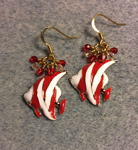 Silver angelfish charm earrings adorned with red and blue Czech glass beads.