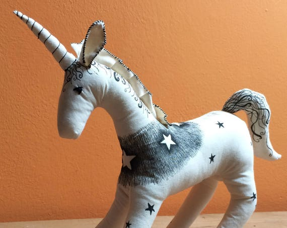 Motley: Hand decorated unicorn art doll