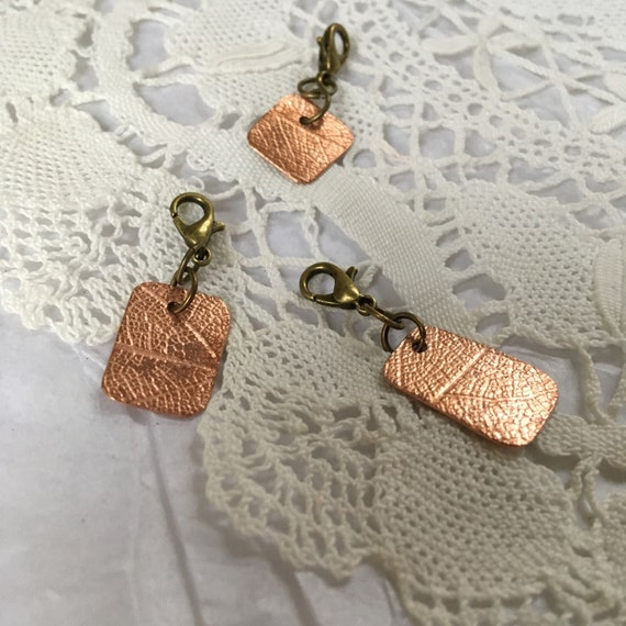 Copper and silver progress keepers for knitting and crochet