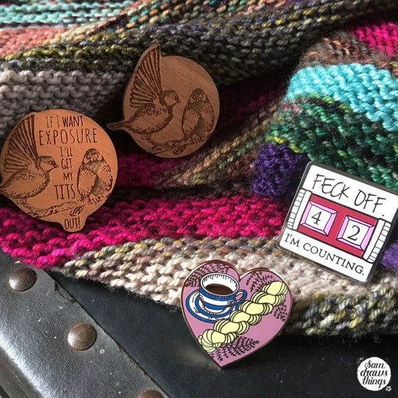 Limited edition knitting and crochet pin collection including #titsoutcollective pin