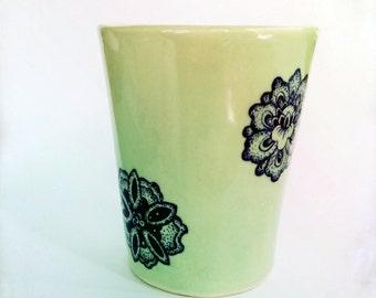 Handmade ceramic tumbler with underglaze decals.
