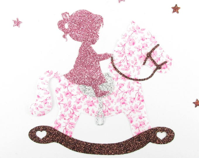 Applied shape in your little girl on her rocking horse in pink liberty fabric Mason and flex glitter patterns fusing baby