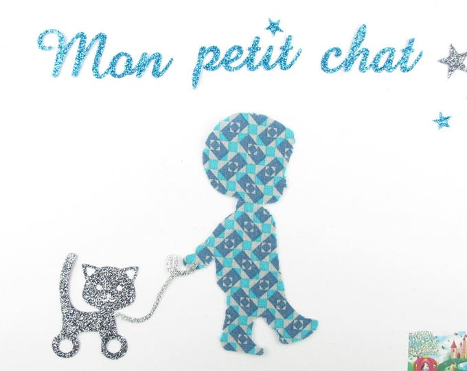 "Applied shape in your little boy ""Kitten"" in blue and grey geometric fabric."