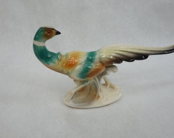 1950's china pheasant figurine, 12.5inches long beak to tail, 9.5 inches tall
