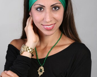 Women and girls green yoga, fitness, running and workout headband in Esmeralda