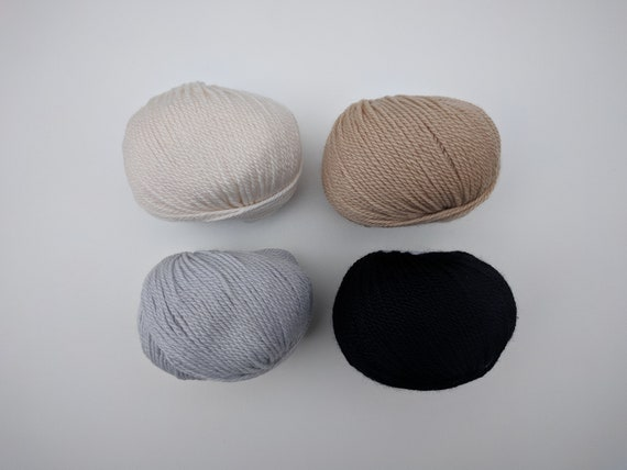 100% Yak, 2 ply & 100% cashmere, 2 ply.
