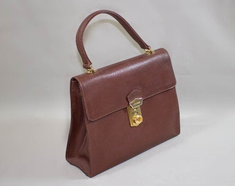 7e1729365b69 leather kelly style handbag   Coccinelle made in Italy bag   Brown genuine leather  handbag handle 80s