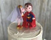 Wonder Woman Kissing Superman Wedding Cake Topper