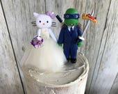 Hello Kitty Bride and Ninja Turtle Groom Wedding Cake Topper