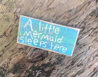 A little mermaid sleeps here