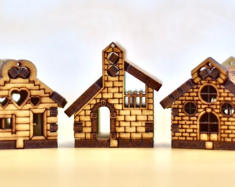 Set of three small wooden houses