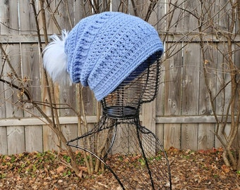 Women's Crochet Slouchy Beanie in Blue with a touch of Sparkle and a Faux Fur White Pom Pom