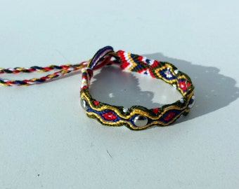 Knotted friendship bracelet with silver studs