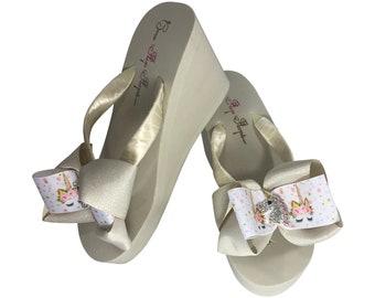 82de73ac77bef Unicorn Bow Flip Flops - White
