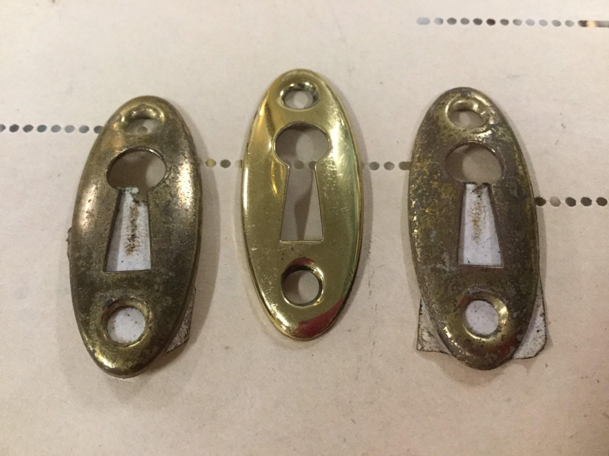 Antique Brass Skinny Oval Key Escutcheon
