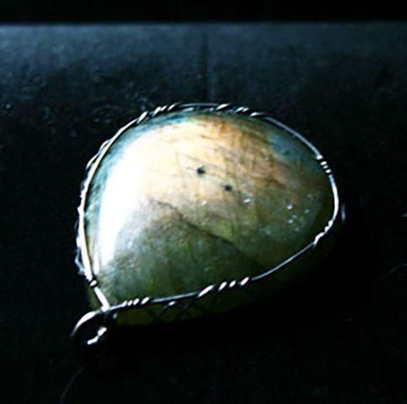 Labradorite pendant with a sterling silver Celtic wrap