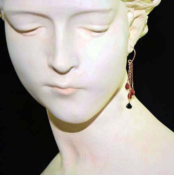 Garnet, gold and spinel earrings