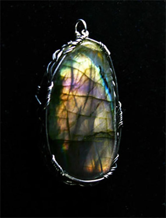 Labradorite pendant wrapped in a sterling silver Celtic design