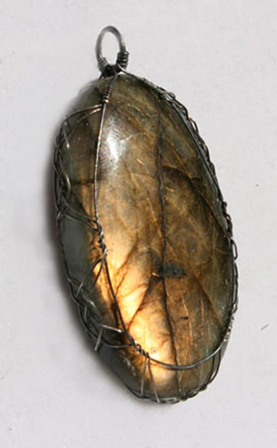 Labradorite pendant wrapped Celtic style with sterling silver