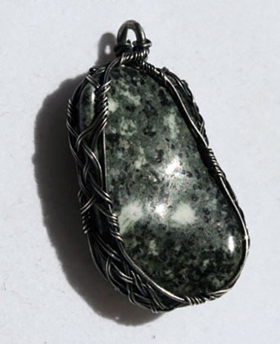 Preseli blue stone wrapped in a Celtic style with oxidized silver