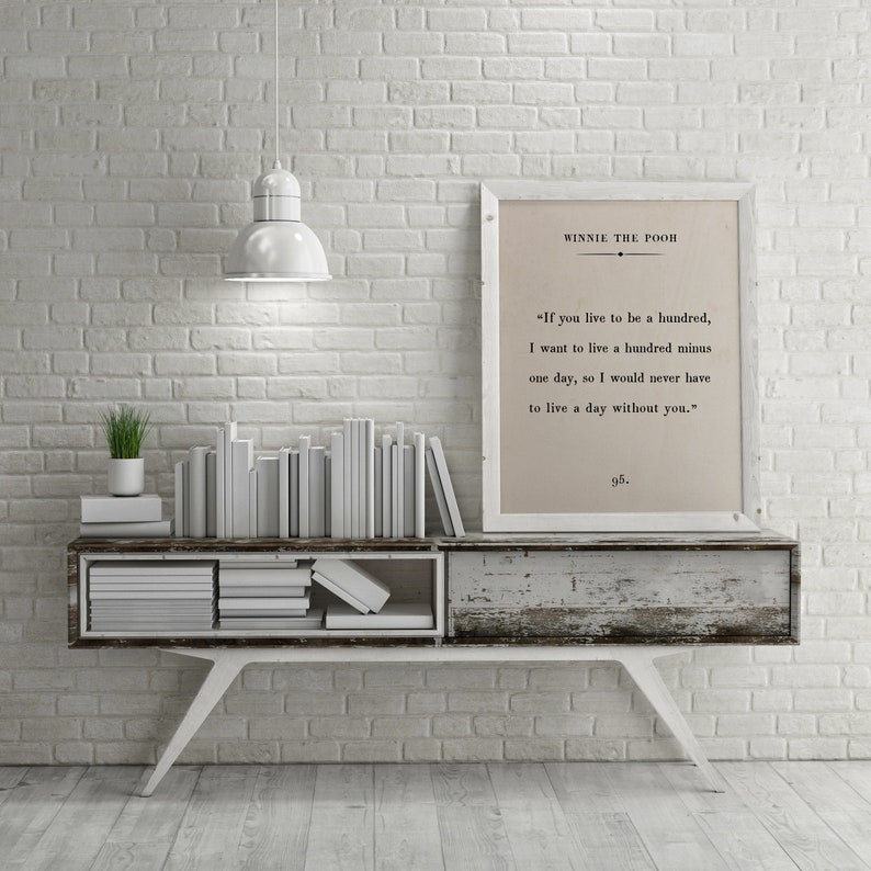 White-colored room with framed Winne the Pooh quote