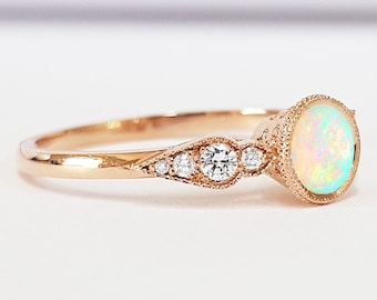 Opal and diamond engagement ring handmade in rose gold with accent diamonds and engraving filigree milgrain
