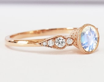 Moonstone and diamond engagement ring handmade in rose gold with accent diamonds and engraving filigree milgrain