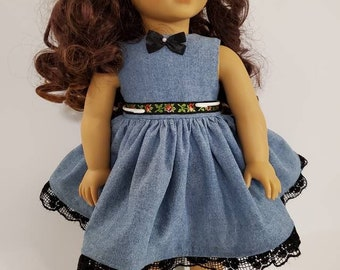 Blue chambray doll dress with black floral trim and black lace. Fits American Girl and other similar 18 inch dolls