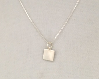 Thin square pendant made of sterling silver