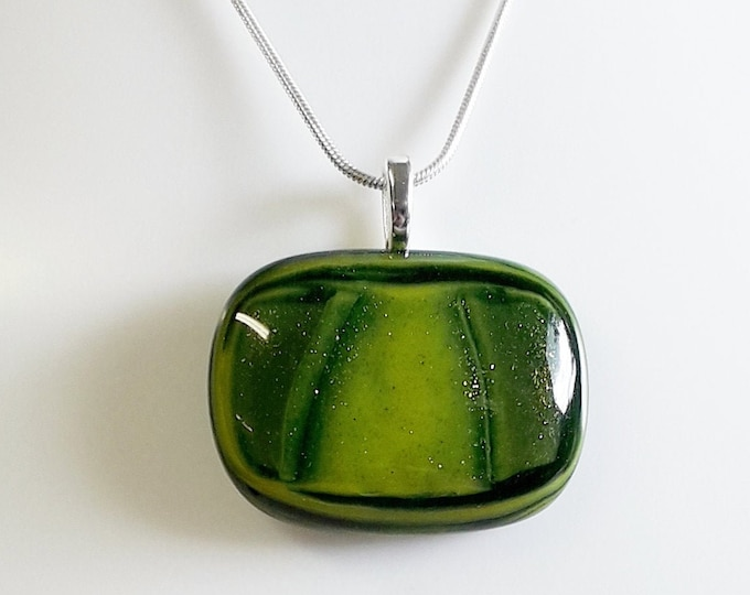 Cast glass pendant, green sparkly glass on silver