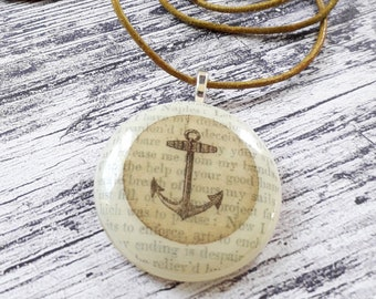 The Tempest fused glass pendant with an anchor illustration and text from Shakespeare's The Tempest.